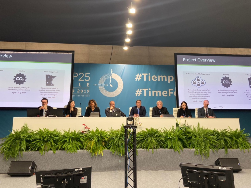 Image of panel discussing how subnational governments can reduce transportation emissions