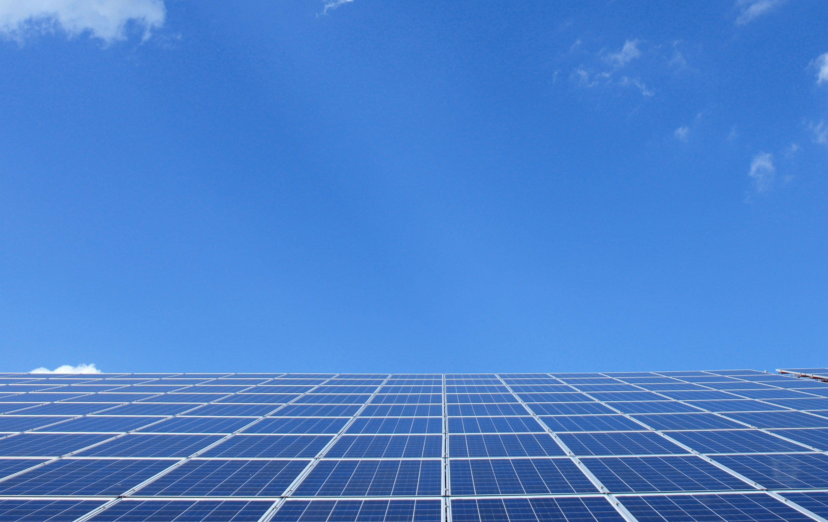 A blue sky and solar panels